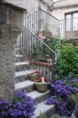 Bloomy courtyard in Erice, Sicily